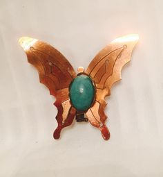 A personal favorite from my Etsy shop https://www.etsy.com/listing/226142479/copper-butterfly-and-jade-ceramic-center