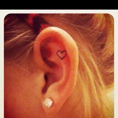 Heart ear tattoo.