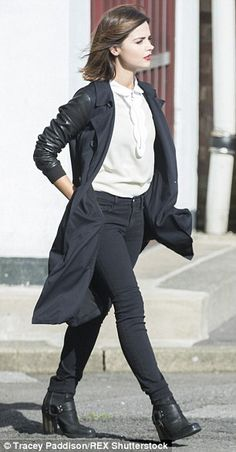 Keeping her cool: She dressed her frame in a dark leather-sleeve coat with tailored trouse...