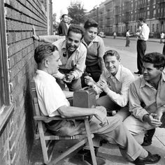 Men listen to a Dodgers-Giants game on the radio in Brooklyn, 1946. http://ti.me/1BJqyX8  (Ed Clark—The LIFE Picture Collection/Getty Images)