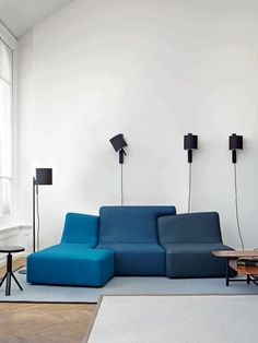 Modular sofa / contemporary / leather / fabric CONFLUENCES Ligne Roset
