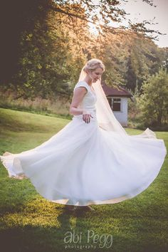 KMR Bride Faye wearing her bespoke wedding gown, veil and headpiece. Faye and Danny August 2015. Photo courtesy of Abi Pegg Photography
