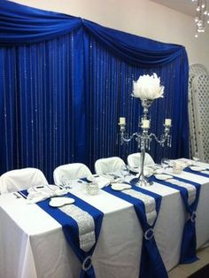 Blue Wedding Decorations For The Tables Elegant - head table with royal blue back drop and cr. Blue Wedding Decorations For The Tables Elegant - head table with royal blue back drop and crystal step curtains<br> Royal Blue Wedding Decorations, Quinceanera Decorations, Wedding Centerpieces, Wedding Colors, Quinceanera Party, Wedding Ideas, Royal Blue Centerpieces, Feather Centerpieces, Tall Centerpiece