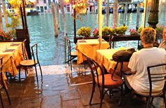 VENICE, ITALY- Rising water levels while dining out next to the water way or canal near Rialto Bridge
