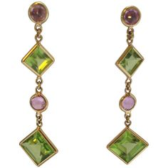 Paolo Castagli Florentine Peridot Pink Sapphire Drop Earrings. 18kt yellow gold pink sapphire and peridot drop earrings consisting of 7 carats of French cut beautiful color peridots and .50 ct of round cut pink sapphires for pierced ears only signed PAOLO COSTAGLI made in ITALY. c1990s