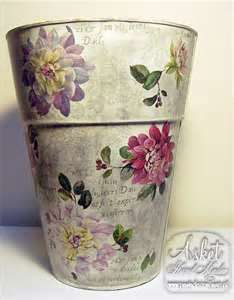A decorative decoupage trash can from an old bucket.