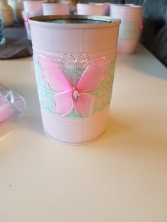 Pink tin with mint laces and a butterfly. Perfect for flowers.