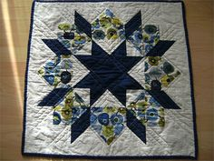 Swoon Block 10 is now a table topper. My daughter loves Apples and her favorite color is navy blue. So I came up with this Idea. Size: 28 x 28""