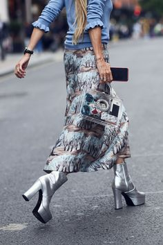 Those Bowie-esque boots, though. #refinery29 http://www.refinery29.com/2016/09/123831/lfw-spring-2017-best-street-style-outfits#slide-36