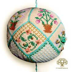 A pincushion ball with a floral design. Available as PDF file/Paper Chart.