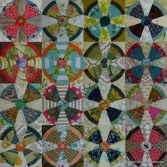 Steam Punk (or Propeller) quilt blocks in pinks, greens, blues and reds.