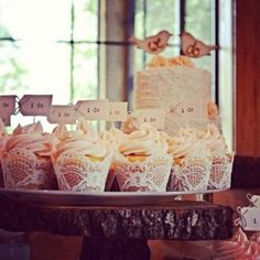 Bridal shower cupcakes using lace wrappers.  See more bridal shower cake ideas at www.one-stop-party-ideas.com