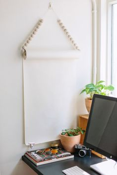 A super-simple jumbo notepad with just a dash of beaded panache make for a simple, sleek command center in this office by A Pair and A Spare DIY.