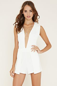 A sleeveless romper crafted from textured knit with a layered front silhouette, a plunging V-neckline, and an invisible back zipper.