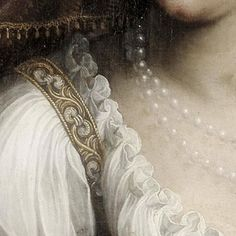 Fede Galizia: Giuditta con la testa di Oloferne. Olio su tela del 1596. Ringling Museum of Art, Sarasota, Florida. Il particolare della camicetta tutta plissettata che finisce con la ruches e la spallina dell'abito che è finemente ricamata: un dettaglio delizioso.