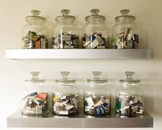 A great way to do this is buy the yankee candles in glass jars and as you use them, clean the wax out and use the jars for the shelf!! Im saving mine now!!