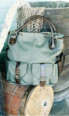 I love everything about this bag - love the style, the color, and accents!