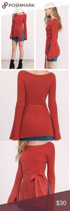 Pumpkin Spice Off The Shoulder Slide Slit Sweater Bare some skin in this fall off the shoulder sweater featuring a high side slit, belt and bell sleeves. 50% polyester 45% acrylic 5% angora.  Fits true to size.  20% off BUNDLES OF 2 or more items. Bundles of 1 will be ignored, REASONABLE offers appreciated & welcome. ❌no trades. Honey Punch Sweaters