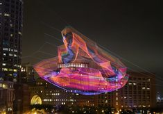 A Monumental Sculpture of Colorful Twine Netting Suspended Above Boston  http://www.thisiscolossal.com/2015/07/net-sculpture-janet-echelman/