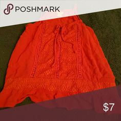 Orange Spaghetti Strap Top Never worn. Size medium. Great condition! Will consider all reasonable offers. :) Would look great with the Forever 21 button up shirt, also for sale in my closet. *will be updating with better pictures tomorrow Tops Blouses