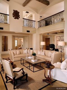 Christopher K. Coffin. Lovely living room with second story balcony.