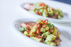 Salmon with avocado and mango salad.