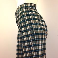 """⚫️VNTG 70s Poly Bell Bottoms Totally badass high waisted vintage 1970s plaid polyester knit bellbottoms! Classic color scheme of dark greenish blue, mustard, & white. Features big cuffs, two button & zipper closure in front, & a little stretch. Excellent condition: like new; no signs of wear, No tags, fits like a L. Waist:30-32"""". Rise:12"""". Hips:42-44"""". Inseam:30"""". Leg opening:12"""". Total length:42"""".  Vintage Pants Boot Cut & Flare"""