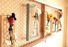 Create a unique piece of wall art that doubles as a floral arrangement with a couple of household items and some chicken wire.