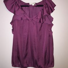 Ann Taylor Loft blouse Wine color with ruffled sleeves and vneck. Elastic bottom. Looks great with many pants. 100% polyester and has a sheen to it. Ann Taylor Tops Blouses