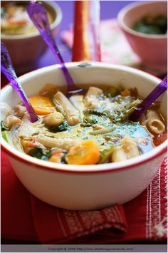 Nourishing Soups — a rustic soup with carrots, red onion, tomatoes, spinach, chickpeas, pasta...