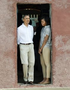 "President Barack Obama and First Lady Michelle Obama look out from the Door of No Return"" on Goree Island."
