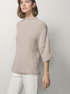 SHORT-SLEEVED SWEATER WITH A FUNNEL COLLAR