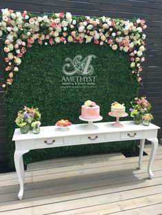 boxwood flower wall for a dessert table backdrop