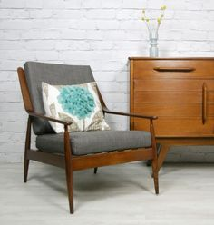 Vintage 1960s reupholstered armchair.  http://www.ebay.co.uk/itm/VINTAGE-RETRO-TEAK-MID-CENTURY-DANISH-STYLE-ARMCHAIR-CHAIR-EAMES-ERA-50s-60s-/120908519467?pt=UK_Antiques_AntiqueFurniture_SM=item1c26b5982b