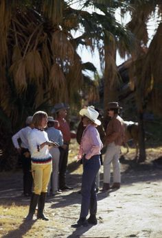 A group of horse riders chat during a break in their journey through Andreas Canyon, Palm Springs, southern California, January 1970. Photo by Slim Aarons