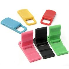 Universal Foldable Mini Stand Holder For iPhone Samsung. Universal Foldable Mini Stand Holder For iPhone Samsung     Description:  You can adjust the display of stand holder and make it sutable for your phone.  Fashional design, Flexible,cute,can randomly carry.  Easy to carry, you can take it to the bureau or chicken and even everywhere.  Free your hands, but enjoy playing your phone at the same time.     Please note: This is a non-OEM product NOT ORIGNAL     Feature:  Size: 52.38 x 22.21…