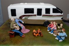 This unique camper cake represented the Happy Couple and all their grandchildren.