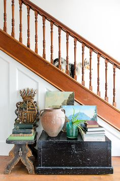 Love the wood railing very lovely with the white raised panel wainscot below!