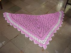 This was one of the 10 shawls I did in 2010. I use yarn from my stash. It is a very thin yarn used for machine knitting. I used 3 strands held together. Though the colour is very pretty it was not looking beautiful. I added the white for the border and the pretty colour came to life. The pattern is called Midsummer's Night Shawl from Crochet Me library.
