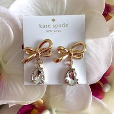 NEWKate Spade Tied Up Bow Drop Earrings Flirty and feminine, these drop earrings combine signature bow hardware with clear glass teardrop stones. kate spade Jewelry Earrings