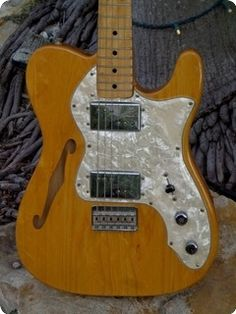Gorgeous early production 2nd series Tele Thinline in a Natural finish over a super grainey Ash body, great feeling maple neck dated October 1971 having only 1 string tree, its factory Humbuckers are