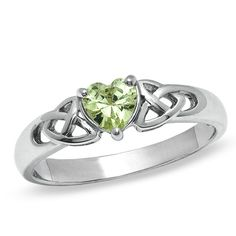 "Green Heart-Shaped Cubic Zirconia Fashion Celtic Triqueta Ring in Sterling Silver - Size 7 - PAGODA.COM ~~ A sweet and shimmering design, this sterling silver fashion ring features a green heart-shaped cubic zirconia center stone flanked with polished sterling silver ""X""-shaped accents. This ring is available in size 7 only. Sterling silver rings cannot be resized after purchase."
