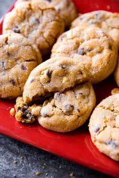 Big peanut butter chunk cookies like you find at a professional bakery! Soft, thick, crinkled, and addicting. Recipe on http://sallysbakingaddiction.com