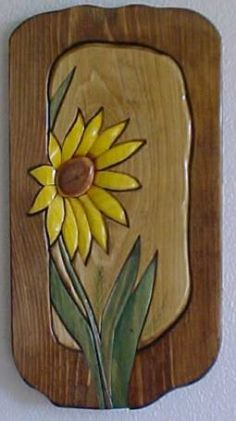 Intarsia sunflower. Woodcarving.                                                                                                                                                                                 More