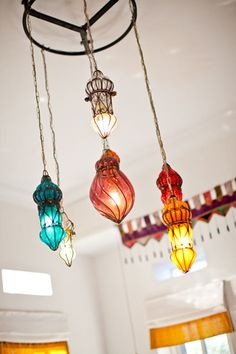 Colorful lanterns grouped together make for a beautiful chandelier feel. Love!