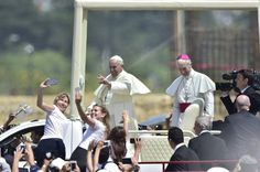 Pope Francis waves at the crowd of faithful gathering for an open-air mass at Samanes Park in Guayaquil, Ecuador, on July 6, 2015.  Pope Francis, in South America on a three-nation tour, will perform mass in Ecuador Monday, with more than a million faithful -- many of whom camped out overnight -- expected to attend. AFP PHOTO/RODRIGO BUENDIA        (Photo credit should read RODRIGO BUENDIA/AFP/Getty Images)