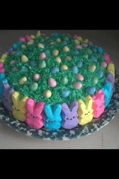 Easter peeps cake just a pix but cute. The grass is colored coconut. I put a few drops of color with coconut in a sandwich or larger ziplock and just knead it with your fingers until all is coated and you get the color you desire.