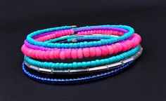 This vibrant wrap bracelet is made on 6 rows of silver memory wire and is filled with colorful glass Czech and bugle beads in pink, aqua blue, purple, turquoise, and silver.   ★ Return to my main shop page here for more inventory ★ www.etsy.com/shop/bridgetollbeading  ★ Read my FAQs below and if you have any further questions please do not hesitate to contact me! ★ https://www.etsy.com/shop/BridgeTollBeading?ref=hdr#more-section