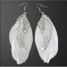 Angel Wing Earrings Cute silver toned zinc alloy earrings with white feathers. Actual feathers may vary in size and shape slightly due to them being real feathers. New! Jewelry Earrings