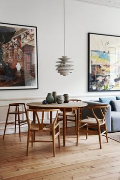 The dining table and Wishbone chairs are by Hans J. Wegner and the high chair is by Nanna Ditzel. The hanging lamp is by Poul Henningsen. (And everything is from Everclassic.)